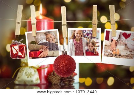 Hanging christmas photos against focus on christmas candles and decorations