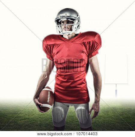 American football player in red jersey looking away against american football posts