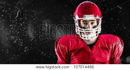 Portrait of american football player wearing his helmet against rain