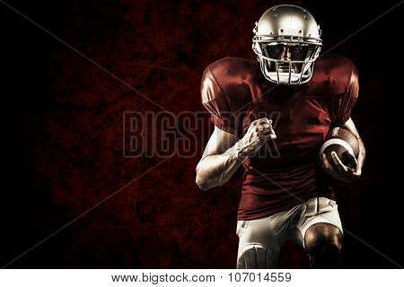 American football player in red jersey running against dark background