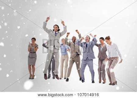 Very enthusiast business people jumping and raising their arms against snow