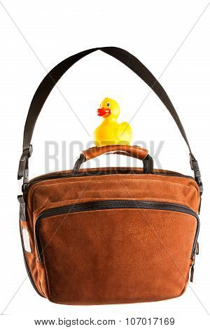 Brown Shoulder Bag And Rubber Duck Isolated On White