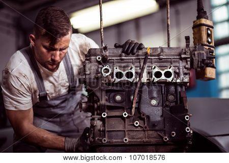Engineer Fixing Engine