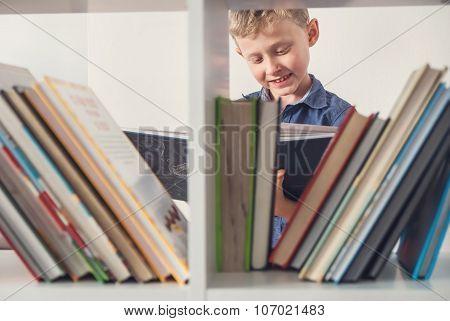 Boy Take A Book From The Book Shelf