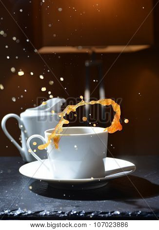 Splash Of Hot Coffee In A Cup