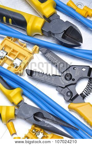Pliers strippers and cables with electrical component