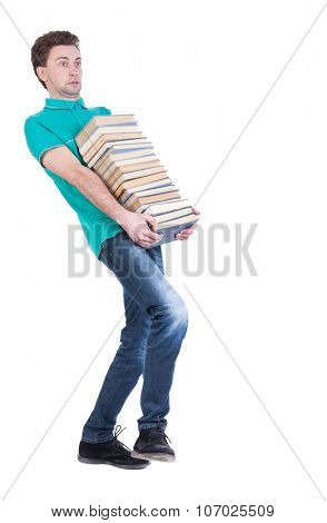 front view of going  handsome man carries a stack of books. walking young guy . Rear view people collection.  backside view of person.  Isolated over white background.