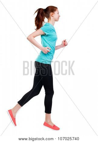 back view of running sport woman. beautiful girl in motion. backside view of person.  Rear view people 