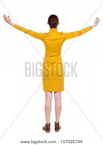 Back view of Beautiful woman in dress looking at wall and Holds  hand up. young blonde girl standing. Rear view people. Isolated over white background. Young woman in prayer.