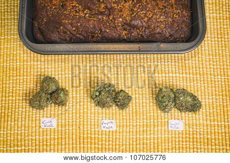 Detail of freshly baked pot brownie tray with different marijuana buds