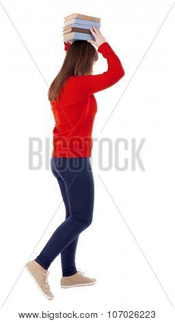 Girl comes with  stack of books.back view. Rear view people collection.  backside view of person.  Isolated over white background.