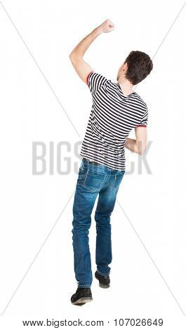 Back view of  man.  Raised his fist up in victory sign.   Rear view people collection.  backside view of person.  Isolated over white background.