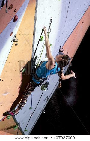 Female sport climber on the climbing wall
