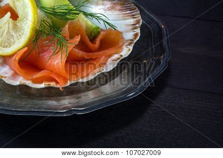 Festive Appetizer,  Salmon In A Scallop Shell On A Silver Plate On Dark Wood