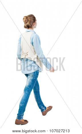 back view of walking  woman. beautiful girl in motion.  backside view of person.  Rear view people collection. Isolated over white background. Girl in a vest pass us by....