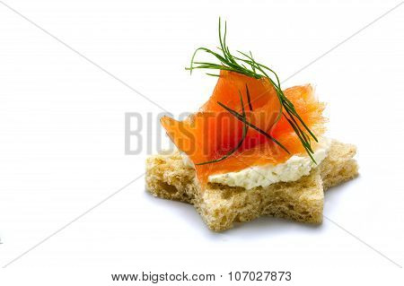 Canape In Star Shape With Smoked Salmon For Christmas, Isolated On White