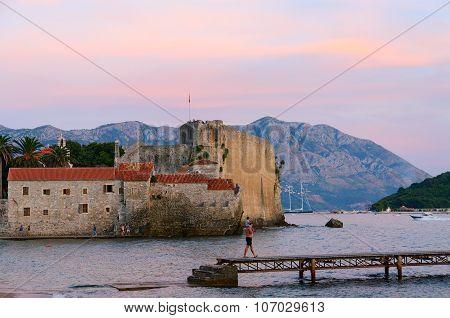 View Of Citadel Of Old Town Of Budva And Sveti Nikola Island At Sunset