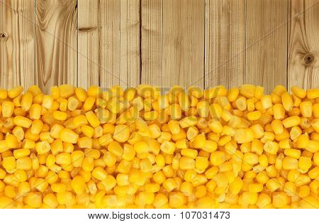 Yellow Corn Grain Isolated On Wooden Table Background