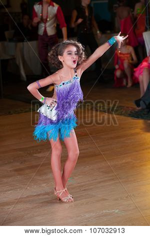 MOSCOW - OCTOBER 18: Unidentified female children age 10-12 compete in latino dance on the Artistic Dance Awards 2014-2015, organized by World Dance Artistic Federation on October 18, 2015 in Moscow.
