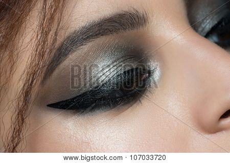Closeup image of beautiful woman eye with fashion makeup. Makeup with eyeliner. Cosmetic Eyeshadow.