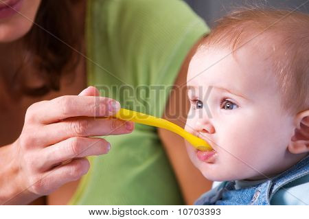 Mother Feeding Hungry Baby