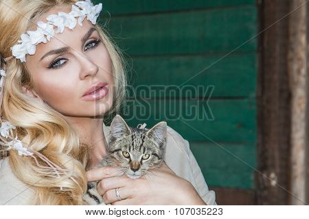 Beautiful blond woman with long hair pretty sexy eyes and mouth on the wild west with a sweet gray k