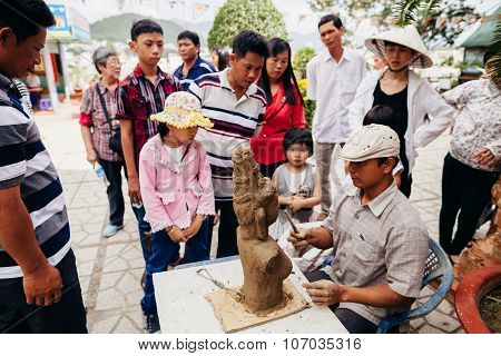 Nha Trang, Vietnam - Circa February 2015 - Unidentified Vietnamese Sculptor Man With Clay And Figure