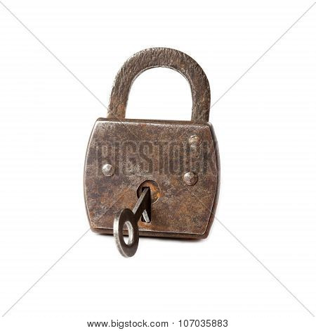 Vintage padlock with key . hanging lock macro view. white background.