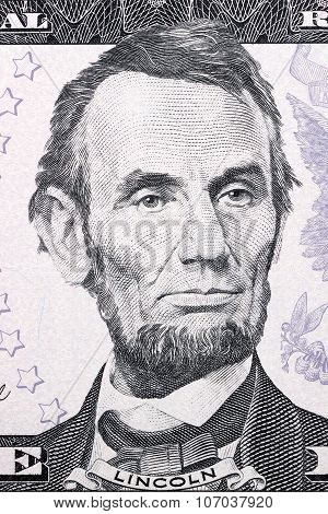 Portrait of Abraham Lincoln on five dollars