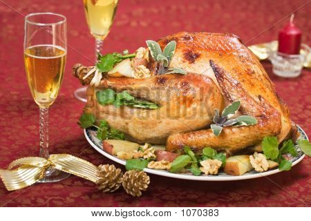 Christmas Turkey On Holliday Table And Flute Of Champagne