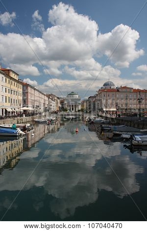 The Grand Canal In Trieste, Italy In Summer Cloudy Day.