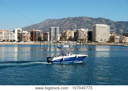 Speed boat with beach to rear, Fuengirola.