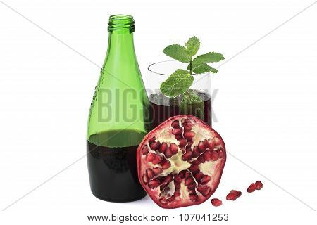 Bottle And Glass Of Pomegranate Juice With Pomegranate And With Melissa