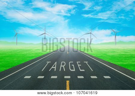 Road Through The Green Field With Sign Target On Asphalt