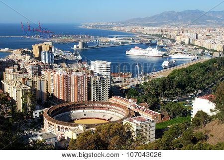 Malaga bullring and port.
