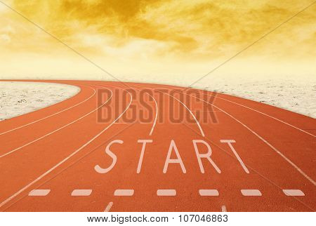 Empty Outdoor Running Track With Sign Start With Desert At Sunset
