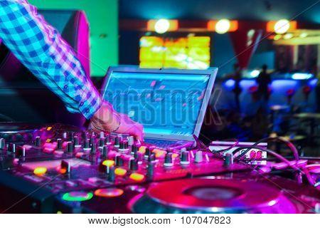 DJ mixer at a nightclub. close-up