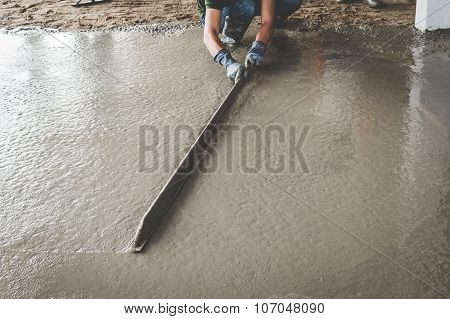 Mason Building A Screed Coat Cement