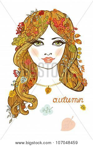 Beautiful girl with autumn leaves.Color portrait