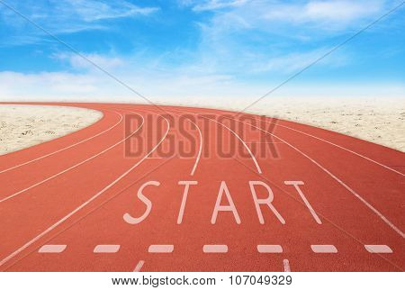 Outdoor Running Track With Sign Start With Desert And Sky Background