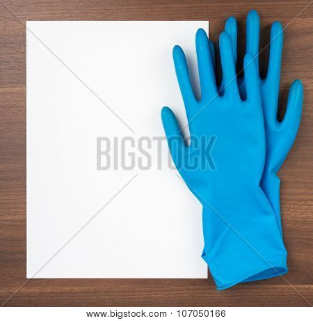 Blank paper with blue rubber gloves