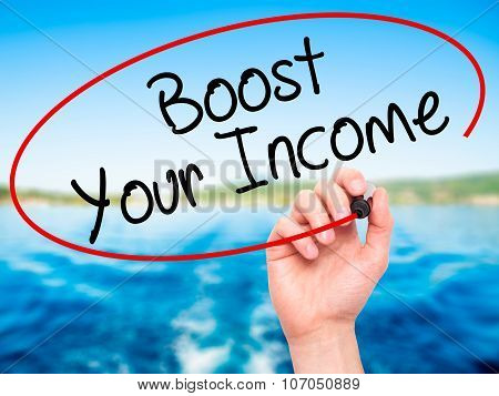 Man Hand writing Boost Your Income with black marker on visual screen