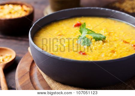 Red lentil Indian soup with flat bread. Masoor dal.
