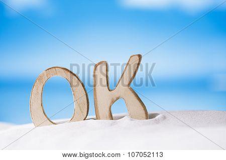 OK message on white sand beach under the sun light, shallow dof