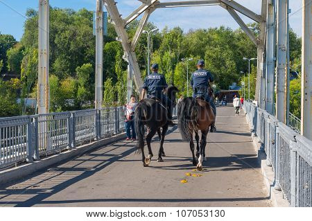 Local police(called miliciya) doing hoeses beat on a bridge over Dnepr river