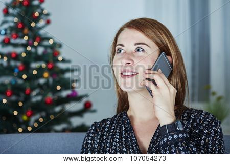 Young Girl Is Chatting On Smartphone