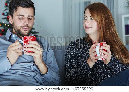 Couple Enjoying Hot Tea Or Coffee