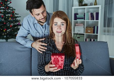 Girlfriend Looks Sceptical To Her Christmas Gift