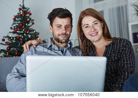 Happy Couple Look On Laptop Pc For Christmas