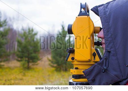 worker with theodolite
